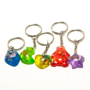 Брелок пластиковый KL-1053 Поцелуйчики, оргстекло с узором внутри 3D, форма: микс, цвет: микс, 8х2.5х0.7см, по 12шт. в пакете (12/600) 00005861