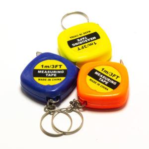 Брелок пластик KL-1140 Рулетка 1м, цвет: микс, 8х3.5х1.2см., в пакете по 12шт. (12/1200) 00006084